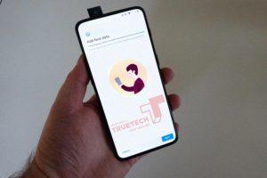 OnePlus 7 hands-on photo appears showing pop-up camera